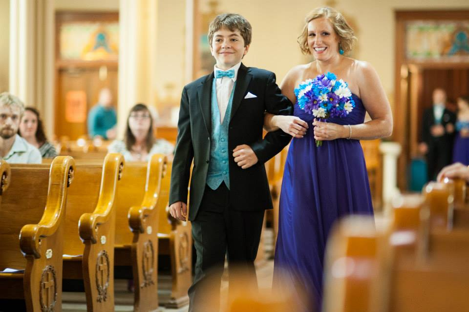 Groomsman Devin escorting bridesmaid, Nicky, down the aisle at my wedding.